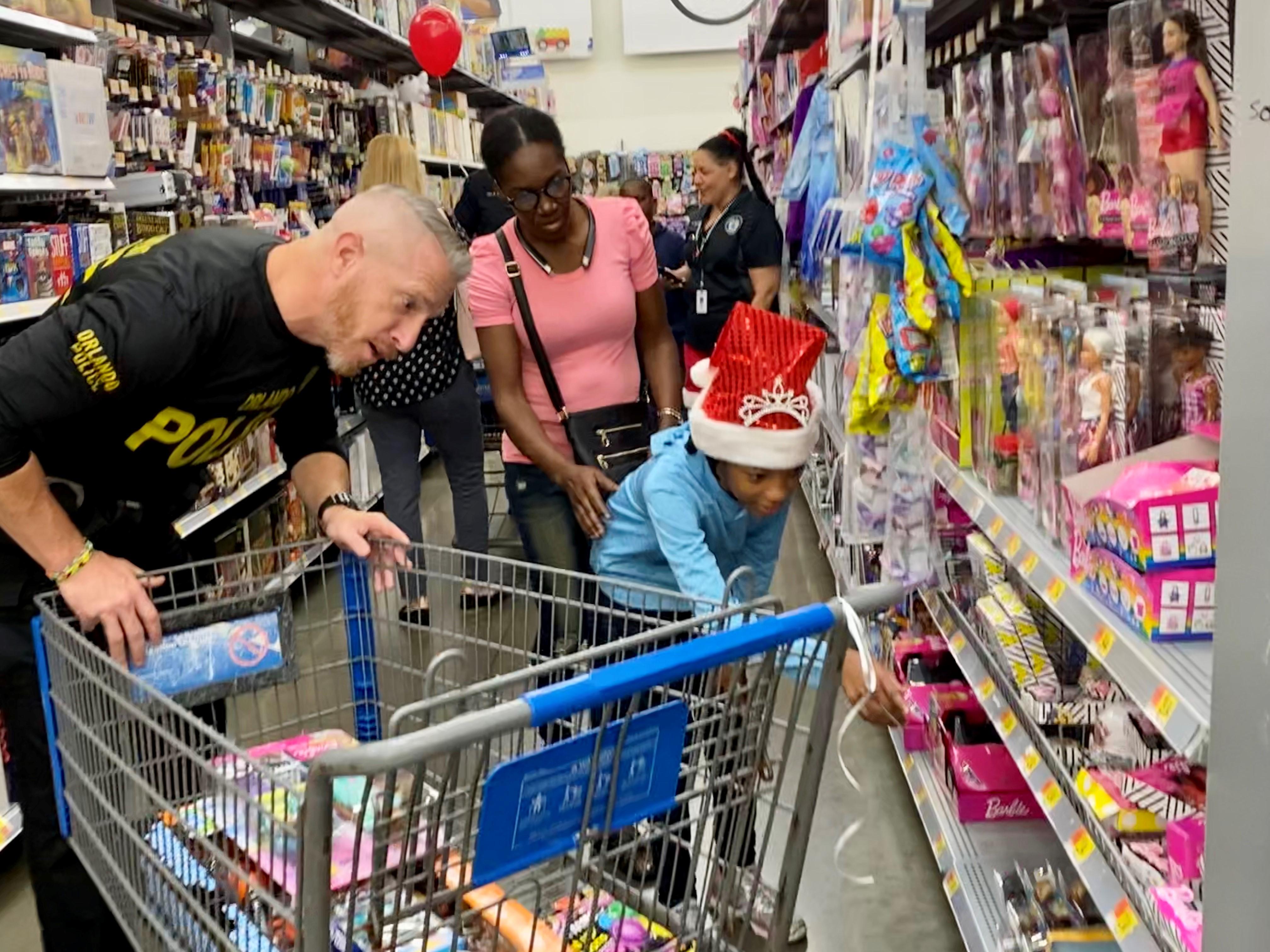 Dozens of kids Shop with a Super Cop in Orlando Walmarts